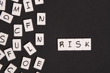 risk taking: risk word with letters block Stock Photo