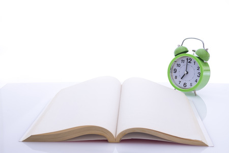empty book: alarm clock and empty book