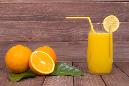 orange juice glass on wood background