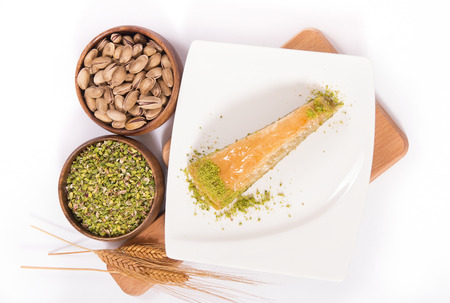 baklava: carrot slice baklava on plate with pistachio