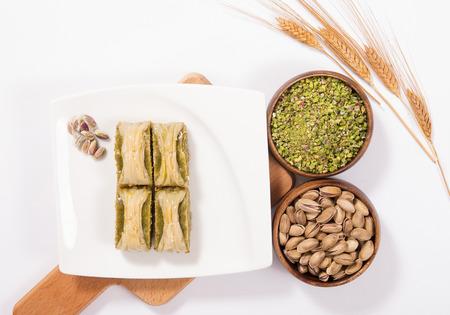 baklava: traditional turkish baklava with wheat spike on plate