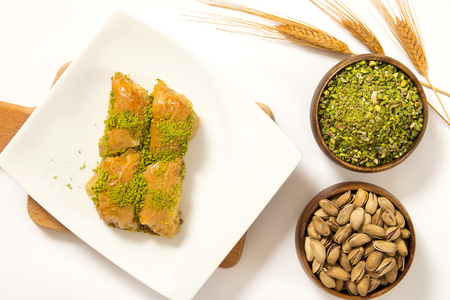 traditional turkish baklava slice on plate with pistachio