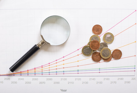 magnifier and coin on the increase graph
