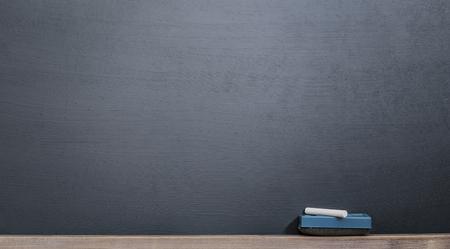 chalk and eraser front of blank blackboard Banco de Imagens