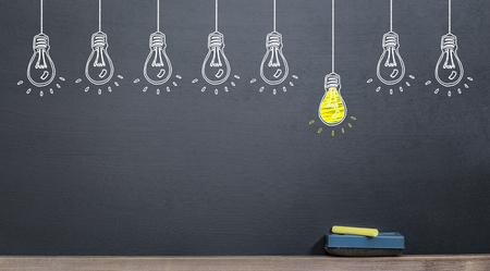 idea concept, yellow lamp on blackboard