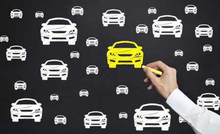 hand drawing car icon. Man point yellow car icon with chalk on blackboard