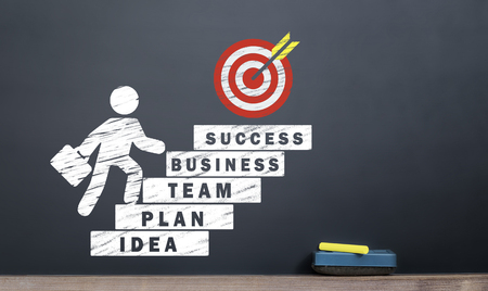 business startup concept. man rising business steps on blackboard