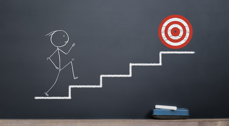 stickman going out of stairs to reach red target. success and target concept on blackboard
