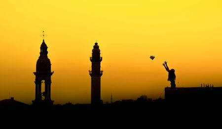 of woman flying a peace dove. Mardin mosque and church together