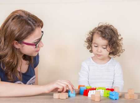 mother teaches colors with lego for daughters intelligence development Imagens