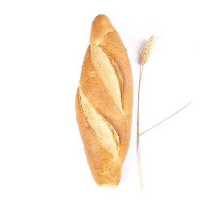 whole bread and wheat ears on a white background