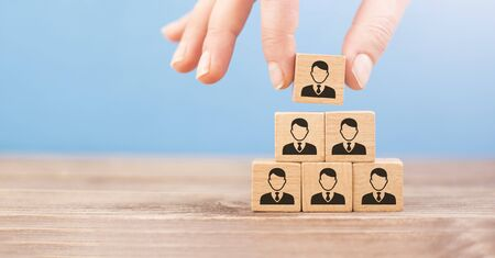 human resources concept, wooden cubes represent stacked personnel hierarchy Imagens