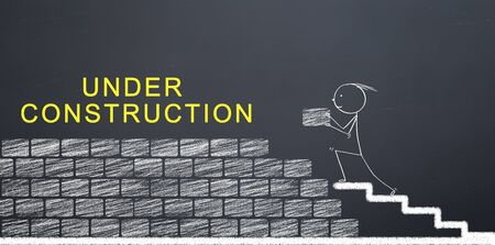 Under construction message for web pages. Technical team is building wall with bricks