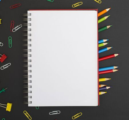 blank notebook pabe and colorful pencils