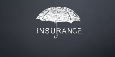 under the umbrella writing the word insurance