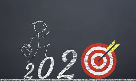 man reaching the target by pressing the numbers 2020. new year career concept