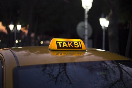 ellow taxi waiting for passengers in the evening