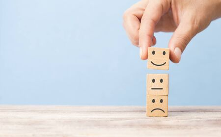 customer satisfaction concept. smiling face on sad face