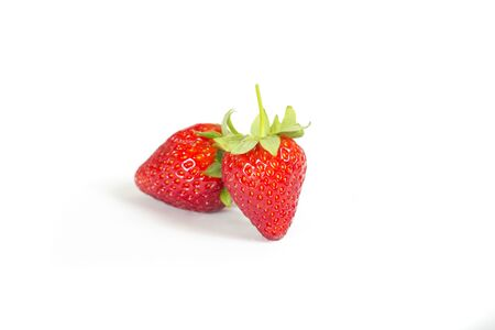studio shoot of fresh strawberries on a white background
