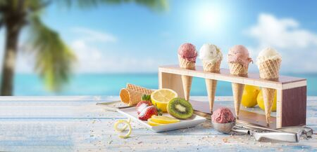 fruit ice cream varieties and fruits on the table, by the ocean