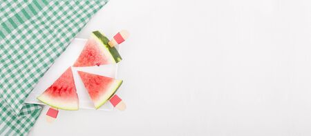 Three slices of watermelon on a white background. Triangle cut chopped watermelon slice