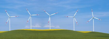 Wind turbines on green mountain grass. Panoramic clean energy concept