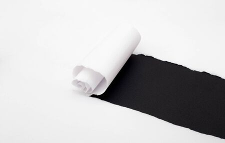 white paper roll ripped in the shape of a black shiny texture