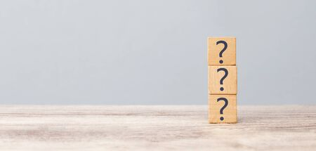 Question marks on the table written in a row on cubes. Frequently asked questions concept