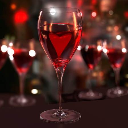 A glass of red wine with a heart. Blurred background.