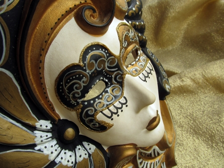Venetian mask on gold background photo