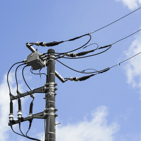 power cables: Technology of electric pole power line transformers and cables. Stock Photo