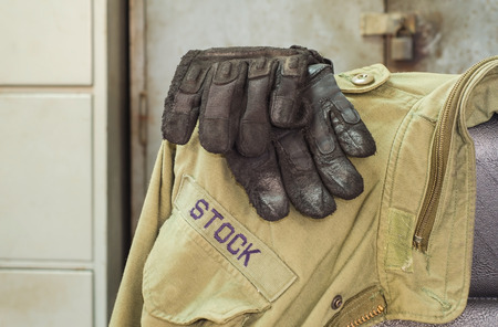 leather glove: Leather glove and jacket for protection.