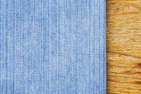 bluejeans: Texture blue jeans and wood. Stock Photo