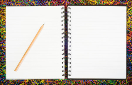 electric wire: Blank spiral notepad notebooks on electric wire.
