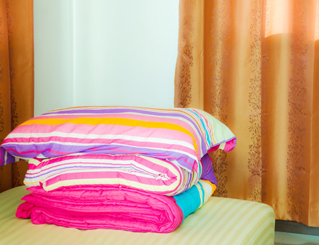 weary: This warm bedroom  inviting offers rest for the weary with comforter and big fluffy pillow on the bed.