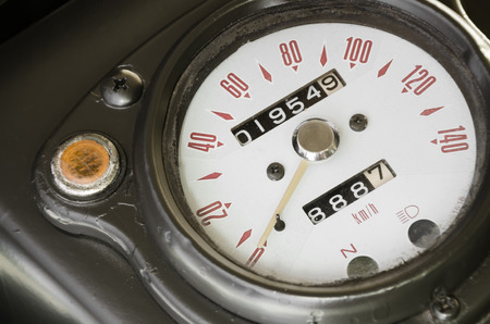 travelled: Speedometer of classic old military motorbike with retro style and selective focus. Stock Photo