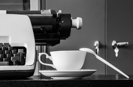 correspond: Typewriter and Coffee Cup; Black and white Photography. Stock Photo