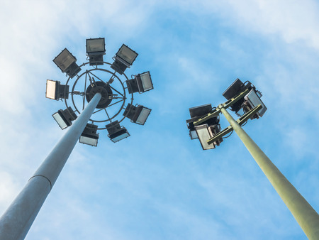 sporting event: Stadium Lights at a Live Sporting Event or Concert, low angle view. Stock Photo