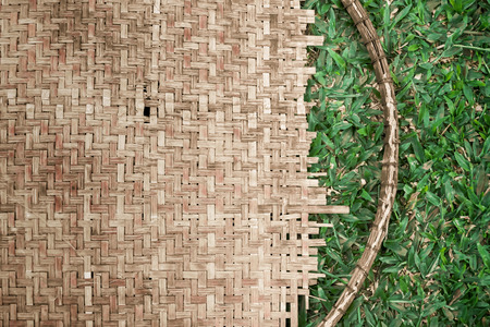 basketry: Asia style bamboo wall, bamboo pattern and grass  basketry handmade. Stock Photo