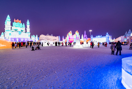 Harbin, Heilongjiang, China - January 11, 2019: Amazing architecture at the ice festival. Ice building in International Ice and Snow Sculpture Festival.  Located in China Harbin Ice and Snow World on sun island in winter that Tourists are visiting.