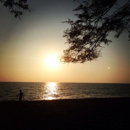 reflective: Sunset on the beach Stock Photo
