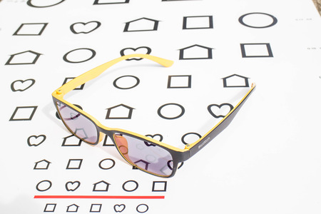 snellen: glasses with near chart Stock Photo