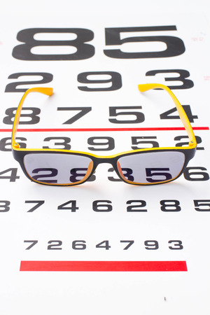 near: glasses with near chart Stock Photo