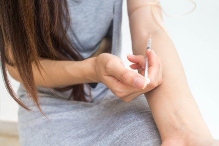 illegality: Hand injection drug Stock Photo