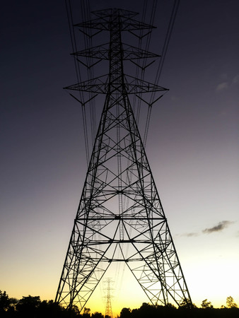 electric pylon at sunset lowlight Standard-Bild
