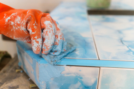 Home renovation - worker tiler Standard-Bild