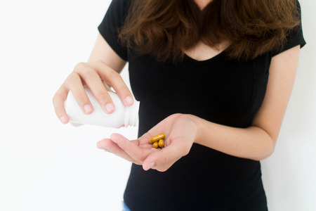 Drugs medicine , health care - close up of woman taking in pill Standard-Bild