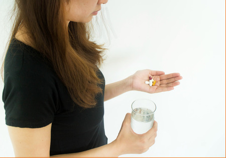 Drugs medicine , health care - close up of woman taking in pill Stock Photo