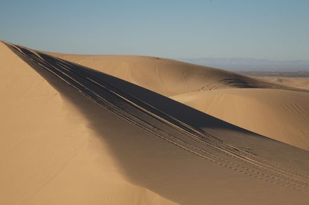 Beautiful sand dunes in Glamis California, with vehicle tracks. Stock Photo