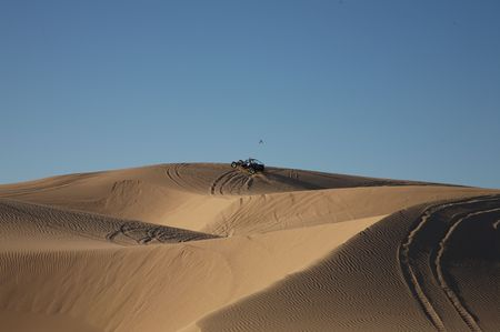 Beautiful sand dunes in Glamis California, with vehicle tracks and a sand rail at the top Stock Photo